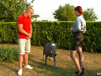 Redhead chick lifts her miniskirt to be fucked in outdoors
