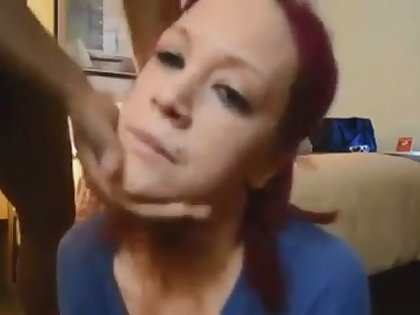 This red haired white chick is enjoying her hunger for my chocolate cock