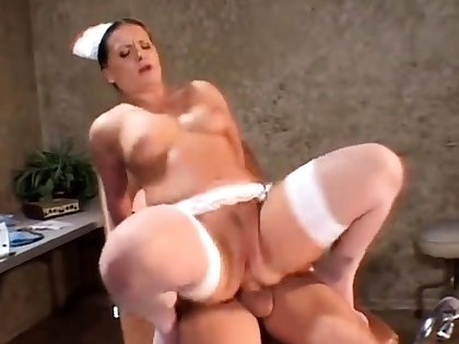Brit mature in stockings wears uniform