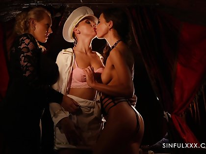 Alluring lesbian women enjoy passionate threesome sexual congress by candlelight